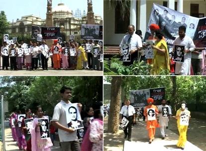 Des photos des sept responsables bahá'ís emprisonnés figuraient bien en vue dans la marche organisée par United4Iran à travers les rues de New Dehli. Les photos sont tirées d'une vidéo.